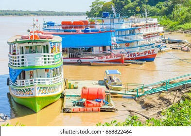 PORTO VELHO, BRAZIL - JUNE 16, 2017: Tour boats on the banks of the Madeira River. Boats departs from Estrada de Ferro Madeira-Mamore carrying many tourists with some onboard food services.