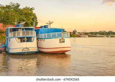 PORTO VELHO, BRAZIL - JUNE 16, 2017: Landscape of  tour boats on the banks of the Rio Madeira at sunset. Touristic traditional boats made of wood on port of the river.