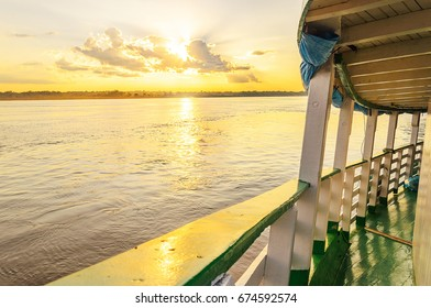 PORTO VELHO, BRAZIL - JUNE 17, 2017: Landscape of a traditional and classic on board of a boat ride on Rio Madeira river at sunset. Boats departs from Estrada de Ferro Madeira-Mamore with tourists.