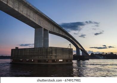 PORTO VELHO, BRAZIL - JUNE 17, 2017: Bridge over the Rio Madeira river on dusk. Bridge linking Rondonia to Amazonas state, Porto velho city with destination to Humaita.