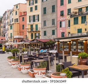 PORTO VENERE, LIGURIA, ITALY - FEBRUARY 27, 2017: Restaurants and coffee shops in front of the marina. Portovenere and the villages of Cinque Terre were designated by UNESCO as a World Heritage Site.