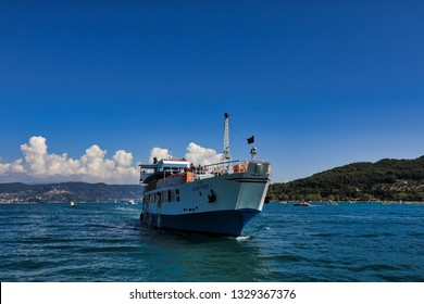 PORTO VENERE (PORTOVENERE), ITALY/EUROPE - SEPTEMBER 4, 2018: Tourists arrive in Portovenere (Porto Venere), Italy via ferry.  This is the travel gateway to Cinque Terre.