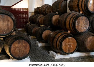 Porto Wine barrels stacked in the old cellar of the winery.