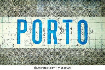 "Porto written in blue letters over traditional Portuguese old tiles (""azulejos�"") in the city of Porto, Portugal, famous for the Porto Wine (""Vinho Do Porto�"")"