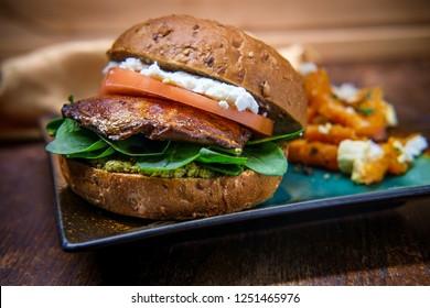Portobello mushroom sandwich with goat cheese pesto and side of Greek sweet potato fries