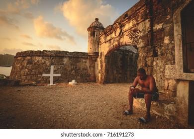 PORTOBELO, PANAMA - APRIL 4, 2014: Local Panamanian visiting the Portobelo fort ruins in Panama