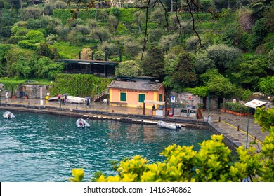 Portofino, Genoa / Italy - April 25 2019: Elevated view of the harbor with the small clubhouse of the Italian Yacht Club, the longest established sailing club in Italy (1879), and a boat fuel station
