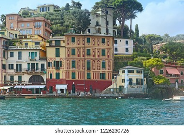 PORTOFINO, ITALY - AUGUST 30, 2018  view of Portofino harbor and waterfront with the painted houses and the trendy shops