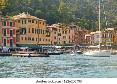 PORTOFINO, ITALY - AUGUST 30, 2018 View of Portofino harbor with the famous Piazzetta (small square) on the waterfront with the ring of coffee bar, shops and restaurants