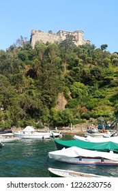 PORTOFINO, ITALY - AUGUST 30, 2018 view from the sea of the medieval Castello Brown, built for Portofino harbor defence in 15th century