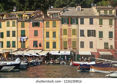 PORTOFINO, ITALY - AUGUST 30, 2018 View of Portofino waterfront with the colorful houses and the  ring of coffee bar, shops and restaurants and boats moored