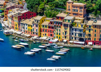 Portofino, Italy - colorful houses and yacht in little bay harbor. Liguria, Genoa province, Italy. Italian fishing village with beautiful sea coast landscape in summer season.