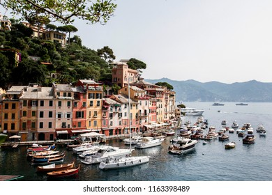 Portofino, Italy - July 01 2012: Boats and yachts sit moored in the marina in Portofino.