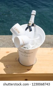 Portofino Italy July 6th 2015 : A bottle of Moet Chandon Ice Imperial champagne and two glasses sitting on a table on Portofino harbour