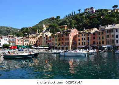 PORTOFINO, ITALY - JUNE 13, 2017: The beautiful Portofino with colorful houses and villas, luxury yachts and boats in little bay harbor. Liguria, Italy, Europe