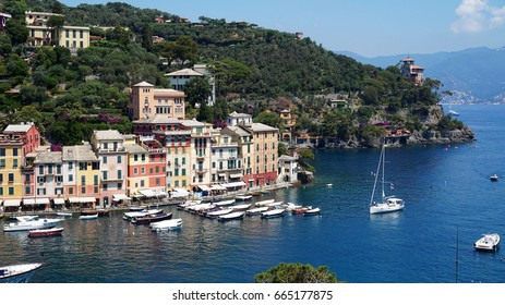 PORTOFINO, ITALY - JUNE 13, 2017: spectacular panorama of Portofino town with its harbour with yachts and boats, Portofino, Liguria, Italy