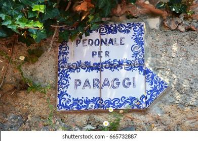 PORTOFINO, ITALY - JUNE 13, 2017: ceramic sign Pedonale per Paraggi, the walking trail on the cliff from Portofino to Paraggi