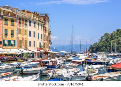PORTOFINO, ITALY - JUNE 26, 2017: Beautiful daylight view to ships on water and buildings in Portofino city of Italy.