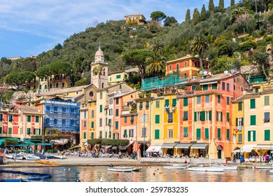 PORTOFINO, ITALY - MAR 7, 2015: Colorful houses of the Piazzetta square of Portofino. Portofino is a resort famous for its picturesque harbour