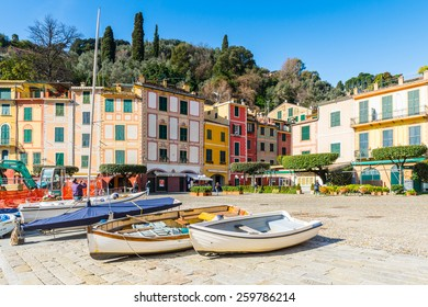 PORTOFINO, ITALY - MAR 7, 2015: Colorful houses and boats on the Piazzetta square of Portofino. Portofino is a resort famous for its picturesque harbour