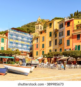 PORTOFINO, ITALY - MAR 7, 2015: Colorful houses on the Piazzetta square of Portofino. Portofino is a resort famous for its picturesque harbour