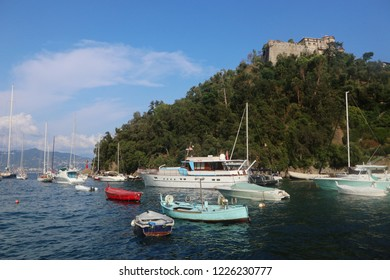 PORTOFINO, ITALY -  view  of the medieval Castello Brown, built for harbor defence in 15th century, towering above the Portofino bay and the boats moored