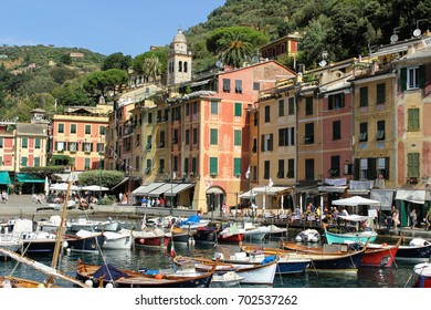 PORTOFINO, ITALY-AUG. 17, 2017:  The harbor area of Portofino is crowded with boats and visiting tourists.  This is a popular destination for travelers.