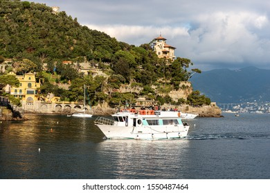 PORTOFINO, LIGURIA, ITALY - DEC 9, 2016: a group of tourists is arriving on a ferry in the port of the famous and ancient village of Portofino. Genoa Province, Liguria, Italy, Europe