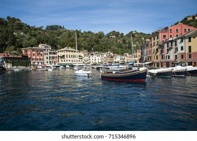 Portofino, Liguria Italy - July 27, 2017: watching the coast from the sea. View of the bay of Portofino, one of the most popular villages on the Italian Riviera.