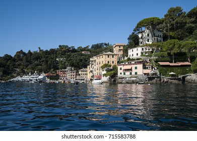 Portofino, Liguria Italy - July 27, 2017: watching the coast from the sea. View of the bay of Portofino, one of the most popular village on the Italian Riviera.