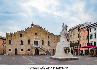Portogruaro, Veneto Italy - May 22, 2019: Cityscape with St. Andrea clock tower, city hall and the WWI monument in Piazza della Republica