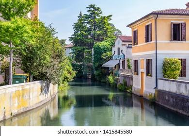 Portogruaro, Veneto Italy - May 22, 2019: Cityscape of Portogruaro in Veneto Italy with lemene river, houses and taverne