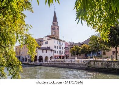 Portogruaro, Veneto Italy - May 22, 2019:  Cityscape of Portogruaro with  Dome Sant Andrea  and Lemene river