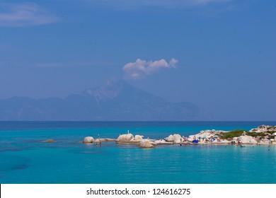 Portokali beach, Halkidiki, Greece with Athos mount on background