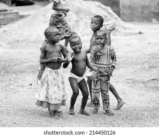 PORTO-NOVO, BENIN - MAR 10, 2012: Unidentified Beninese children play in the street. People of Benin suffer of poverty due to the difficult economic situation