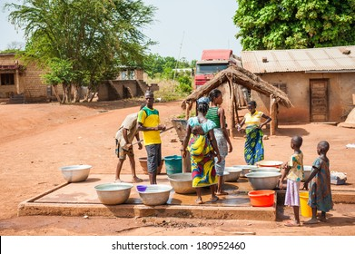 PORTO-NOVO, BENIN - MAR 8, 2012: Unidentified people and children get water from the well. People of Benin suffer of poverty due to the difficult economic situation.
