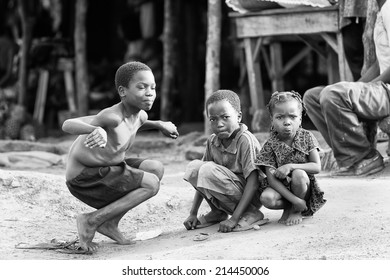 PORTO-NOVO, BENIN - MAR 8, 2012: Unidentified Beninese little children pose for the camera. People of Benin suffer of poverty due to the difficult economic situation.