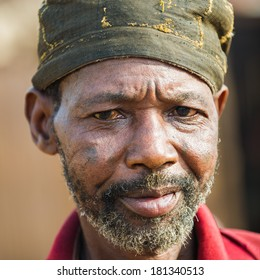 PORTO-NOVO, BENIN - MAR 9, 2012: Unidentified Beninese man in a hat. People of Benin suffer of poverty due to the difficult economic situation.