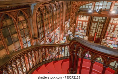 Porto,Portugal - May 7, 2014 : spectacular ceiling made of painted chalk from Libreria Lello and Irmao, the second oldest library in Portugal famous for the Harry Potter film. interior view, Staircase