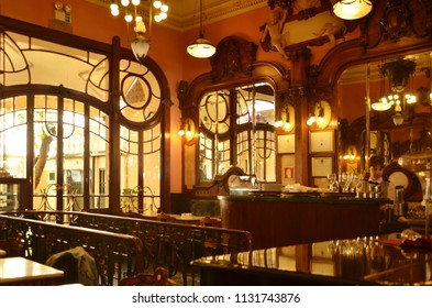 Porto/Portugal_OCT 18 2017: Majestic Café is the most beautiful cafe in Porto. Belle Epoque-era cafe with ornate interior featuring carved wood, leather seat, mirrors & chandeliers.