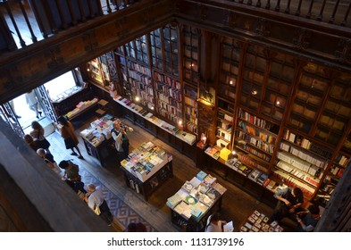 Porto/Portugal_OCT 18 2017: The Most Beautiful Bookstore Livraria Lello, built in 1906, mixing Neo-Gothic & Art Dec elements, carved wood ceilings, stain-glassed roof, and opulent red staircase.