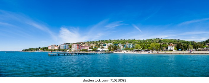 Portoroz, Slovenia - April 17 2017: Large Panorama of Portoroz beach and town are a popular tourist and travel destination during all seasons, especially during spring catching first sunny days
