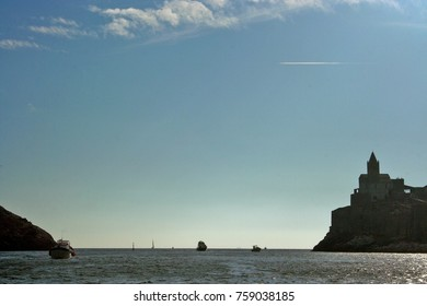 Portovenere: boat and hill with church in backlight