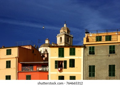 Portovenere: glimpse of colored buildings with cathedral