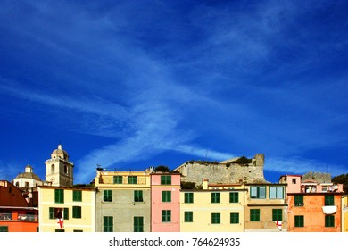 Portovenere: glimpse of colorful buildings with cloudy sky