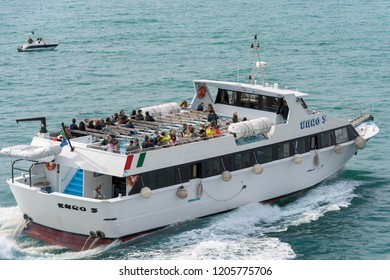 PORTOVENERE, ITALY, MARCH 25, 2016: Ferry boat with tourists during sailing to the Cinque Terre in the Mediterranean Sea in front of Portovenere, Liguria, Italy
