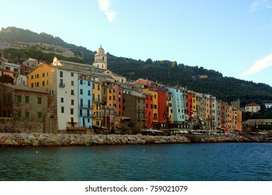 Portovenere: old town, buildings with colored facades, hill, seen from the boat