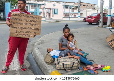 PORTOVIEJO,MANABI, ECUADOR, February 02 2019.  Venezuelan Refugee family asking for money in an Ecuadorian city, February 02 2019.Many refugees from Venezuela are living on the street in Ecuadorian