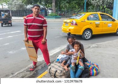 PORTOVIEJO,MANABI, ECUADOR, February 02 2019.  Venezuelan Refugee family asking for money in an Ecuadorian city, February 02 2019.Many refugees from Venezuela are living on the street in Ecuadorian