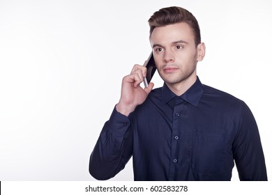 A portrair of a confident business man isolated on white background talking on his phone.